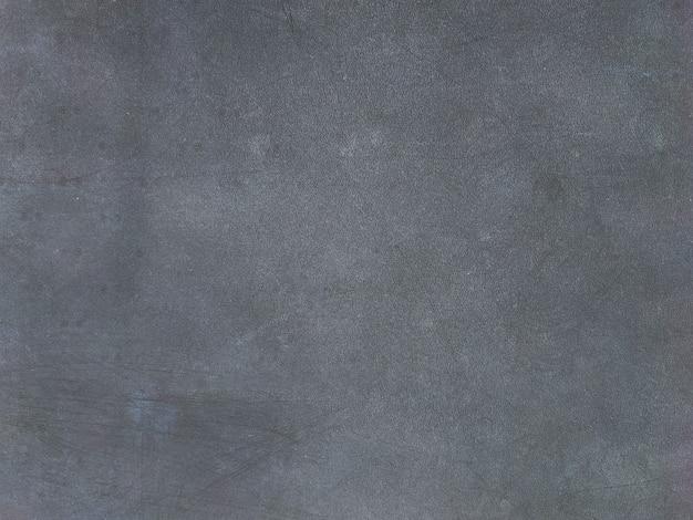 Темная грязная текстурированная стена в деревенском стиле