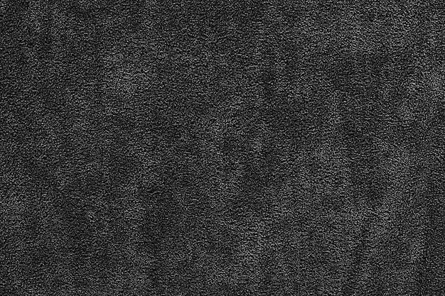 背景の暗い生地のシームレスなテクスチャ