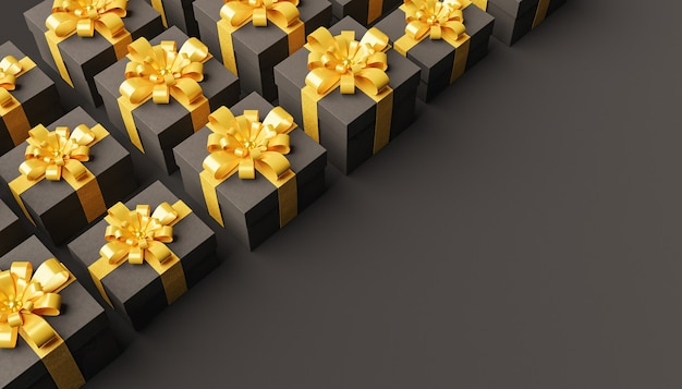 Dark gift boxes with gold ribbons lined in the corner