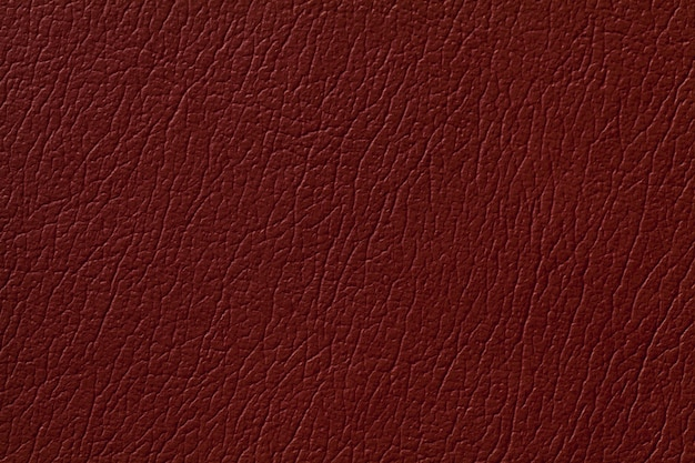 Dark ginger leather texture background with pattern, closeup