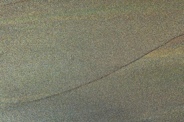 暗いキラキラテクスチャ抽象的な背景。暗く輝く空の表面。ミニマリズム