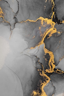 Dark gold abstract background of marble liquid ink art painting on paper .