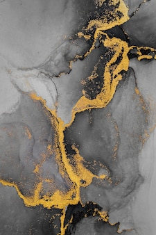 深金色抽象背景的大理石水墨艺术画在纸上。