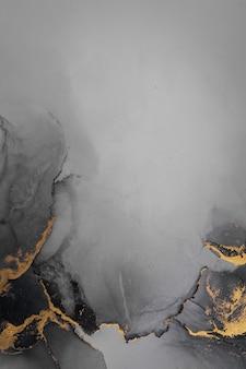 종이에 대리석 액체 잉크 아트 그림의 어두운 금 추상적인 배경.