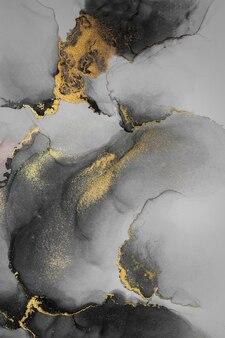 紙に大理石の液体インクアート絵画のダークゴールドの抽象的な背景。