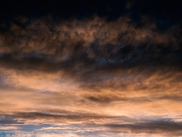 Dark gradient of the evening sky. colorful cloudy sky at sunset.