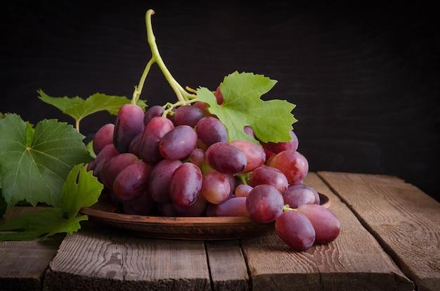 Dark grape in bowl.