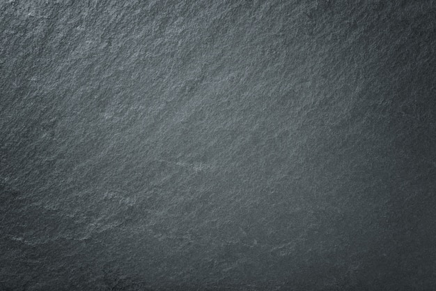 Dark gray background of natural slate. texture black stone closeup.