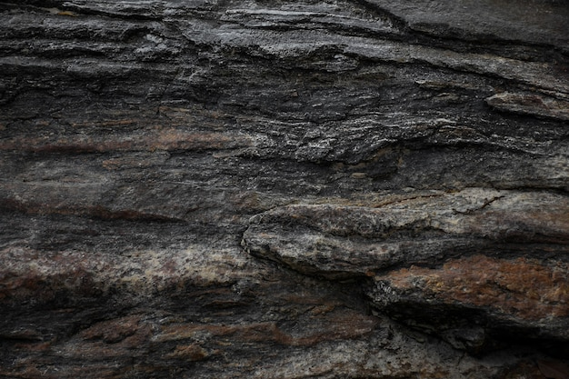 Темно-серый черный сланец камень текстуры фона.