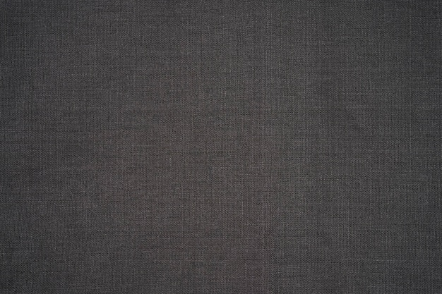Dark gray cloth napkin isolated,  cotton texture top view with copy space