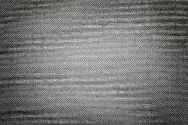 Dark gray from a textile material with wicker pattern, closeup.