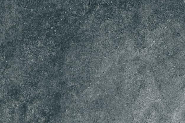 ダークグレーの花崗岩のテクスチャ