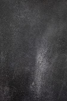 Dark gray rough concrete background