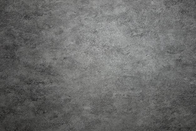 暗い灰色の石の背景。