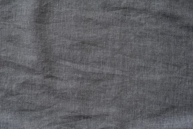 Темно-серая фактурная ткань. крупный план.