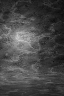 暗い灰色のビンテージテクスチャ壁のスクラッチには、汚れの背景がぼやけています。