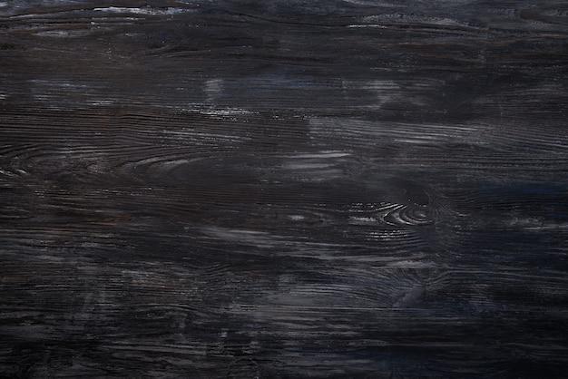 ダークグレーの木の背景の壁のテクスチャ。上面図とコピースペースをクリア
