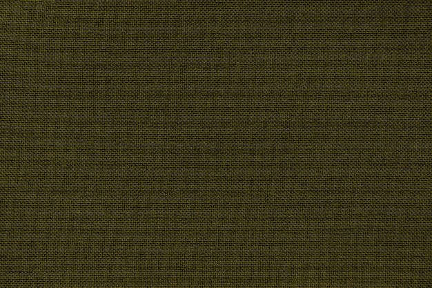 Dark green background from a textile material with wicker pattern
