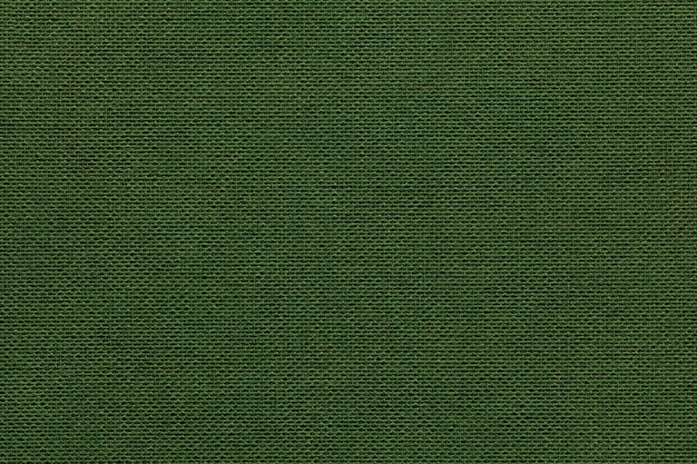 Dark green background from a textile material with wicker
