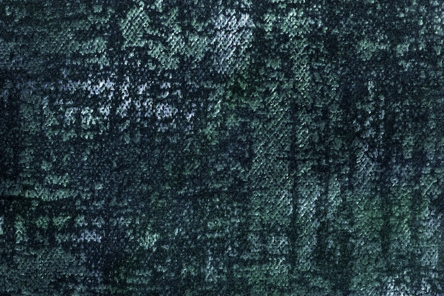 Dark green and blue fluffy background of soft, fleecy fabric. texture of emerald textile
