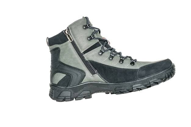 Dark green men's cold weather boot isolated on white surface