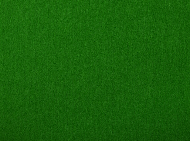 Dark green poker table felt soft rough textile material background texture, close up