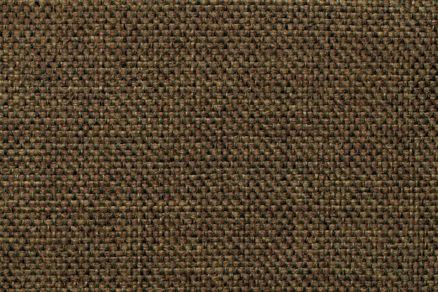 濃い緑色の繊維の背景、クローズアップ。ファブリックマクロの構造。