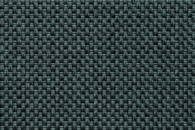 Dark green textile background with checkered pattern, closeup. structure of the fabric macro.