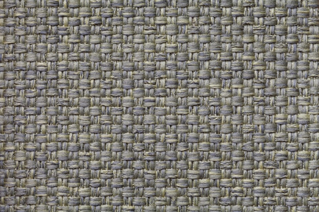 Dark green textile background with checkered ,  structure of the fabric macro,