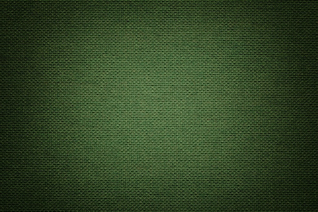 Dark green a textile material, fabric with natural texture.
