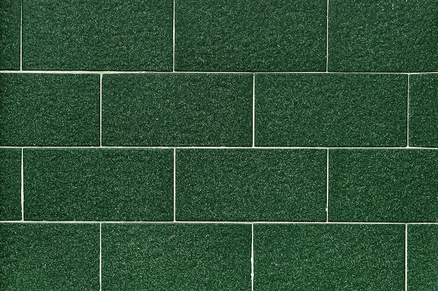 Dark green tiles pattern wallpaper
