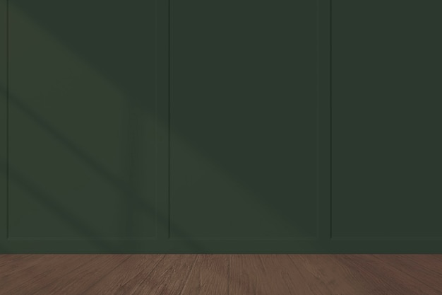 Dark green wall mockup with a wooden floor Free Photo
