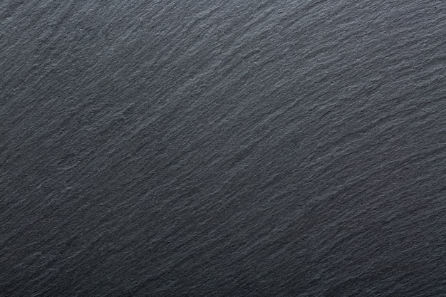 Dark grey and black slate granite background.