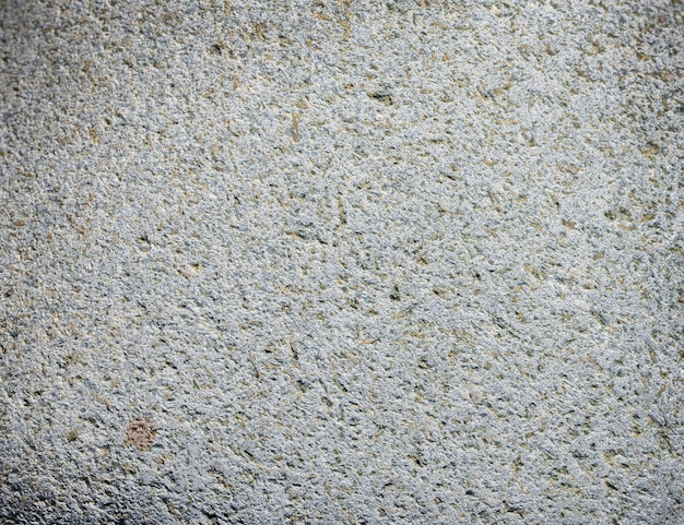 The dark grey black stone background or texture.