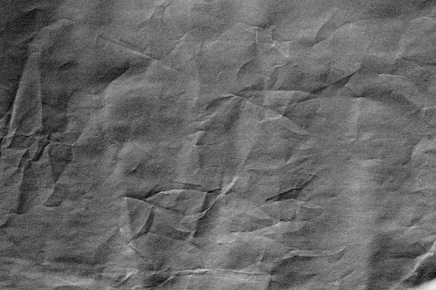 Dark grey crumpled background paper texture