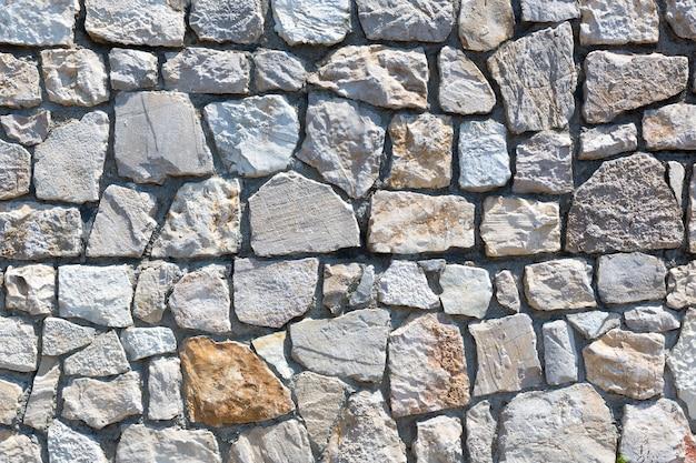 Темно-серый фон каменной стены