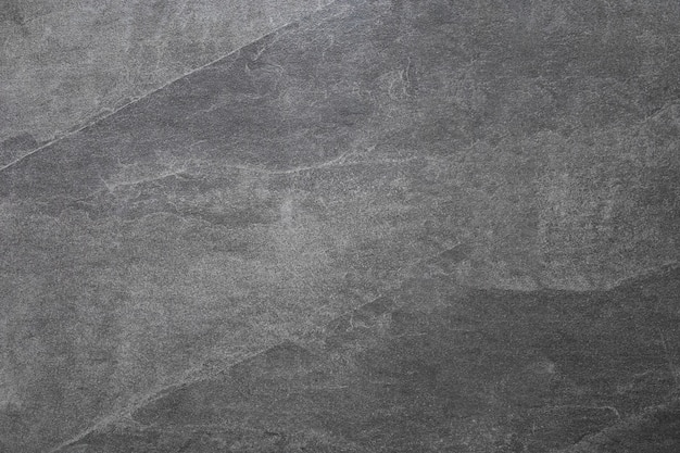 Dark grey stone wall texture  gray rough backdrop stucco surface abstract pattern texture of natural granite abstract art creative background