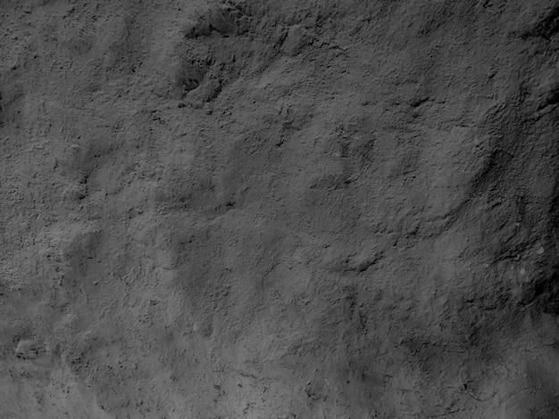 Темно-серая фактурная каменная стена из песка