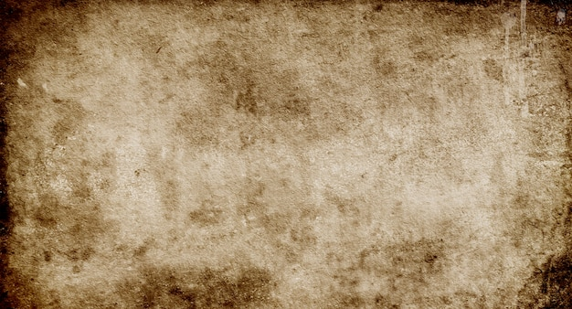 Dark grunge background, texture of old brown paper with spots and streaks