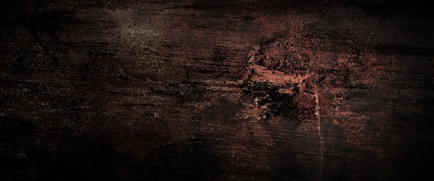 Dark grunge and scratched wall background texture