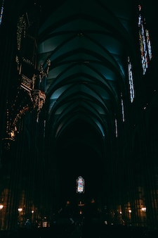 Dark hallway inside notre dame cathedral captured in strasbourg, france