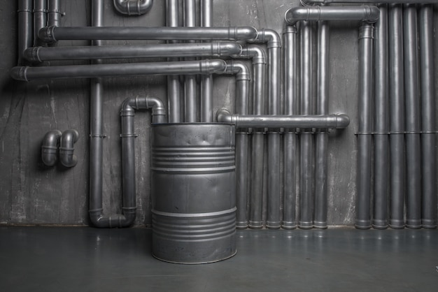 Dark industrial interior with steam pipes