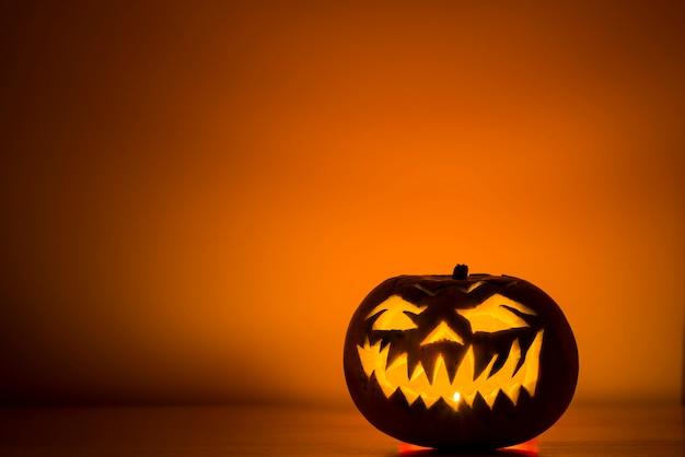 Dark jack-o-lantern witn candle