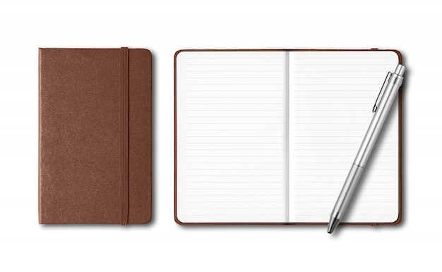 Dark leather closed and open notebooks with a pen isolated on white