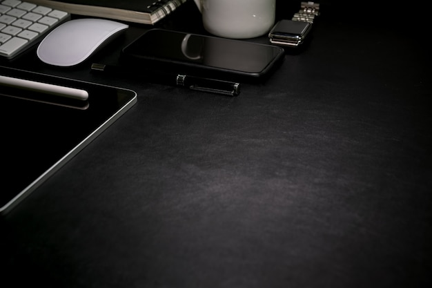 Dark leather desk top table with office supplies and copy space