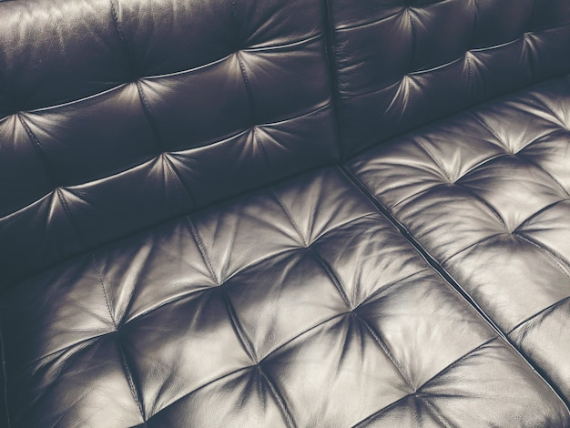 Dark leather texture background with buttoned pattern
