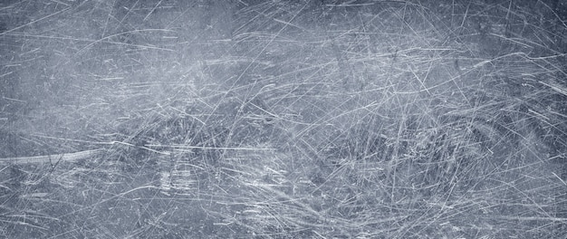 Dark metal texture, old stainless steel background with scuffs and dents