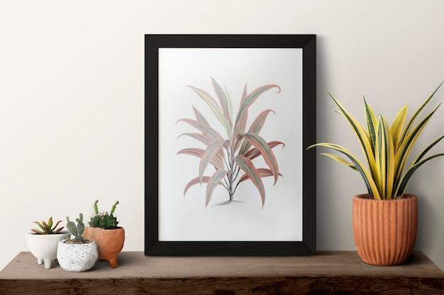 식물이 있는 선반에 있는 어두운 현대 그림 프레임