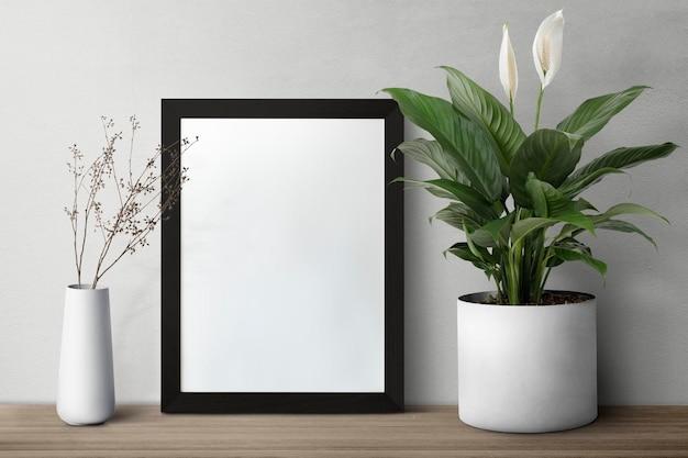 Dark modern picture frame on a shelf