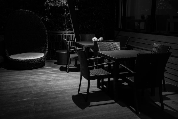 In the dark monochrome of restaurant table in the night